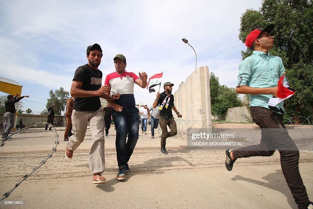 Iraqi protesters head to the parliament after breaking into Baghdad's heavily fortified 'Green Zone' on April 30, 2016. Thousands of angry protesters broke into Baghdad's Green Zone and stormed the parliament building after lawmakers again failed to approve new ministers. Jubilant supporters of cleric Moqtada al-Sadr invaded the main session hall, shouting slogans glorifying their leader and claiming that they had rooted out corruption. / AFP / HAIDAR