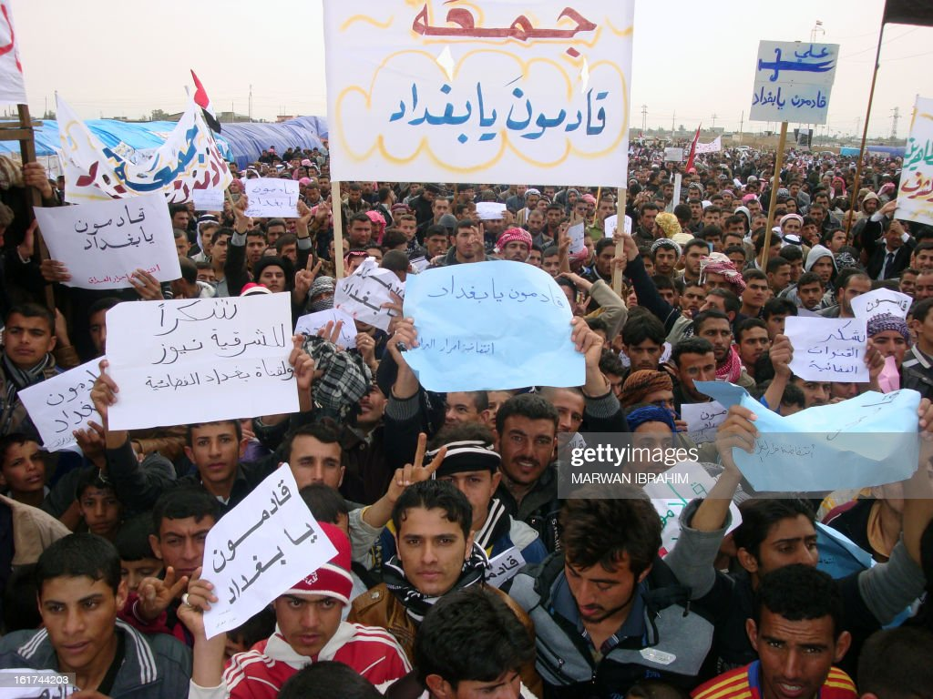 Iraqi protesters hold up placards during a rallye following the Friday's prayers to call for the government's fall on February 15, 2013 in Hawijah near the ethnically mixed city of Kirkuk. The protests began after weekly Muslim prayers in Mosul, Samarra, Kirkuk, Baquba, Ramadi and Fallujah -- all predominantly Sunni -- as well as Sunni-majority areas of Baghdad under heavy security as the central government has voiced fears the rallies had been infiltrated by militants. AFP PHOTO/MARWAN IBRAHIM