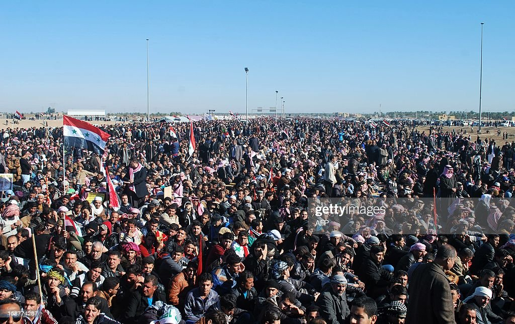 Iraqi protestors call for the release of prisoners they allege were arrested on sectarian grounds by Iraq's Shiite-led authorities during a demonstration in Ramadi, Anbar's provincial capital, on December 28, 2012. Protesters have been demonstrating in Ramadi since December 23, steadfastly blocking the main highway to Syria and Jordan for the past six days.
