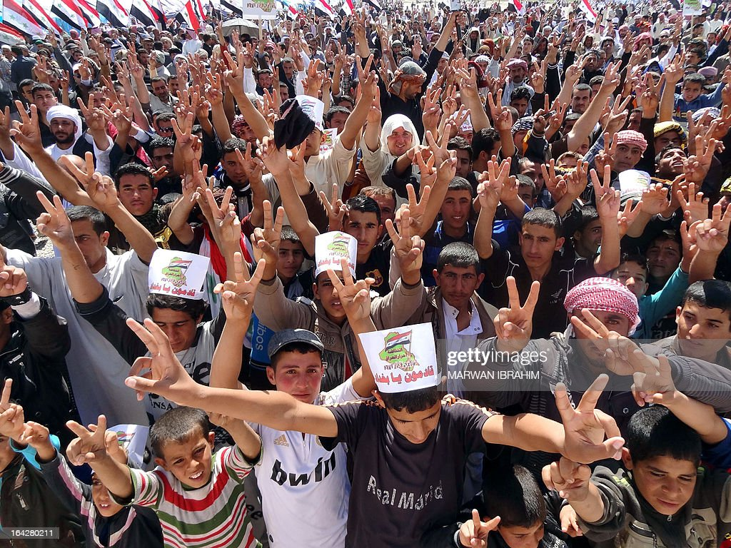 Iraqi protestors flash the sign for victory during a demonstration following the Friday's prayers to call for the government's fall in the northern Iraqi town of Hawijah, south of the ethnically mixed city of Kirkuk, on March 22, 2013. Protesters have taken to the streets in Sunni-majority areas for more than two months, calling for the resignation of Prime Minister Nuri al-Maliki and decrying the alleged targeting of their minority community by the Shiite-led authorities.