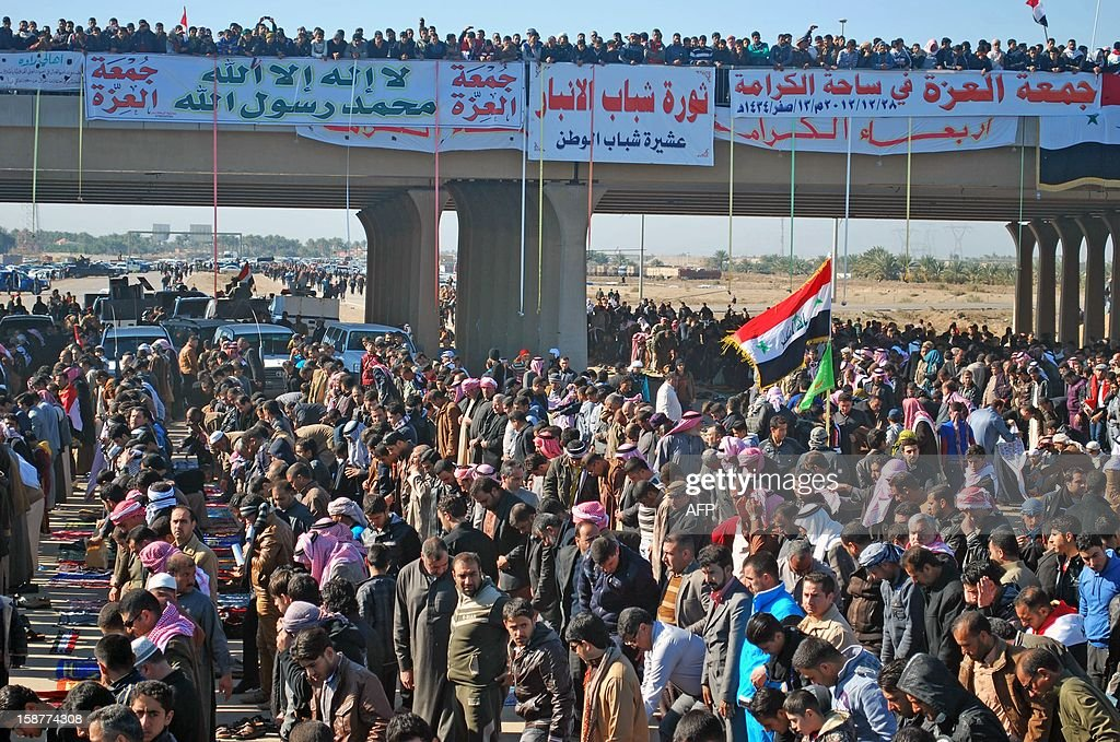 Iraqi protestors pray during a demonstration in Ramadi, Anbar's provincial capital, on December 28, 2012, calling for the release of prisoners they allege were arrested on sectarian grounds by Iraq's Shiite-led authorities. Protesters have been demonstrating in Ramadi since December 23, steadfastly blocking the main highway to Syria and Jordan for the past six days. AFP PHOTO / AZHAR SHALLAL