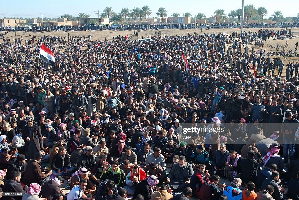 Iraqi protestors pray during a demonstration in Ramadi, Anbar's provincial capital, on December 28, 2012, calling for the release of prisoners they allege were arrested on sectarian grounds by Iraq's Shiite-led authorities. Protesters have been demonstrating in Ramadi since December 23, steadfastly blocking the main highway to Syria and Jordan for the past six days.