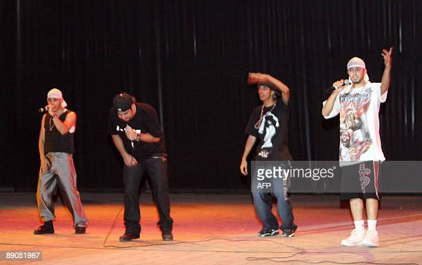 Iraqi rap group DKZ perform at the national theatre in central Baghdad on July 10 2009 Around 150 fans attended the first major concert for the...