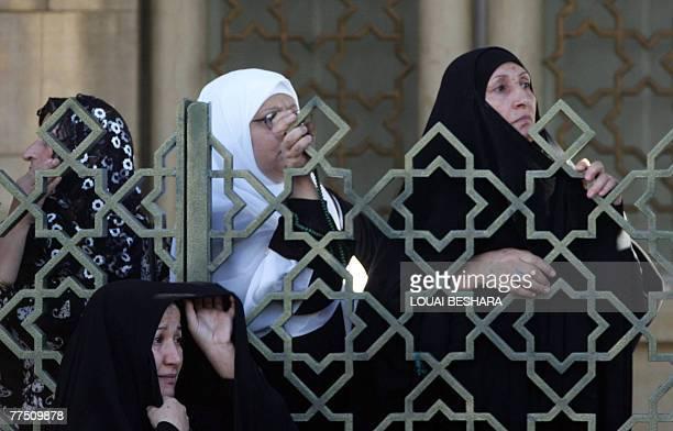 Iraqi refugee women listen to a speech by Iraqi Parliament Speaker Mahmud Mashhadani at the Sitt Zeinab district south of the Syrian capital Damascus...
