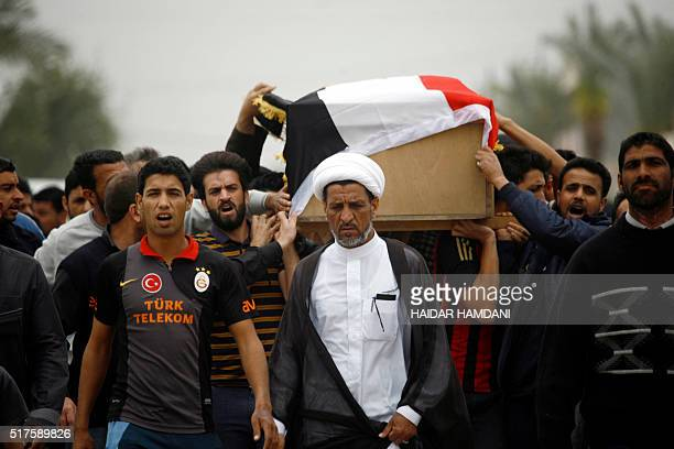 Iraqi relatives and friends mourn on March 26 2016 in Iskandariyah a town about 40 kilometres south of the capital Baghdad during the funeral of some...