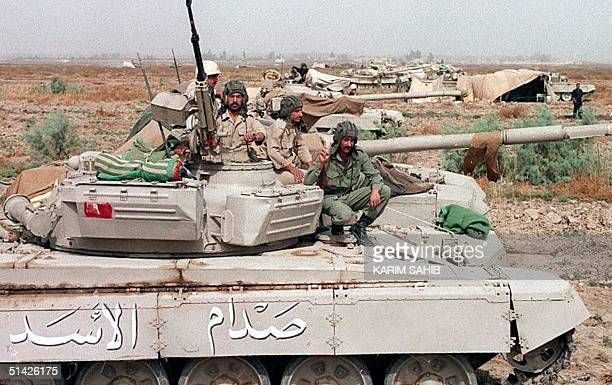 Iraqi republican guards sit on their tanks 30 November 1997 outside Baghdad Iraqi newspapers said 14 November that Baghdad was ready to defend itself...