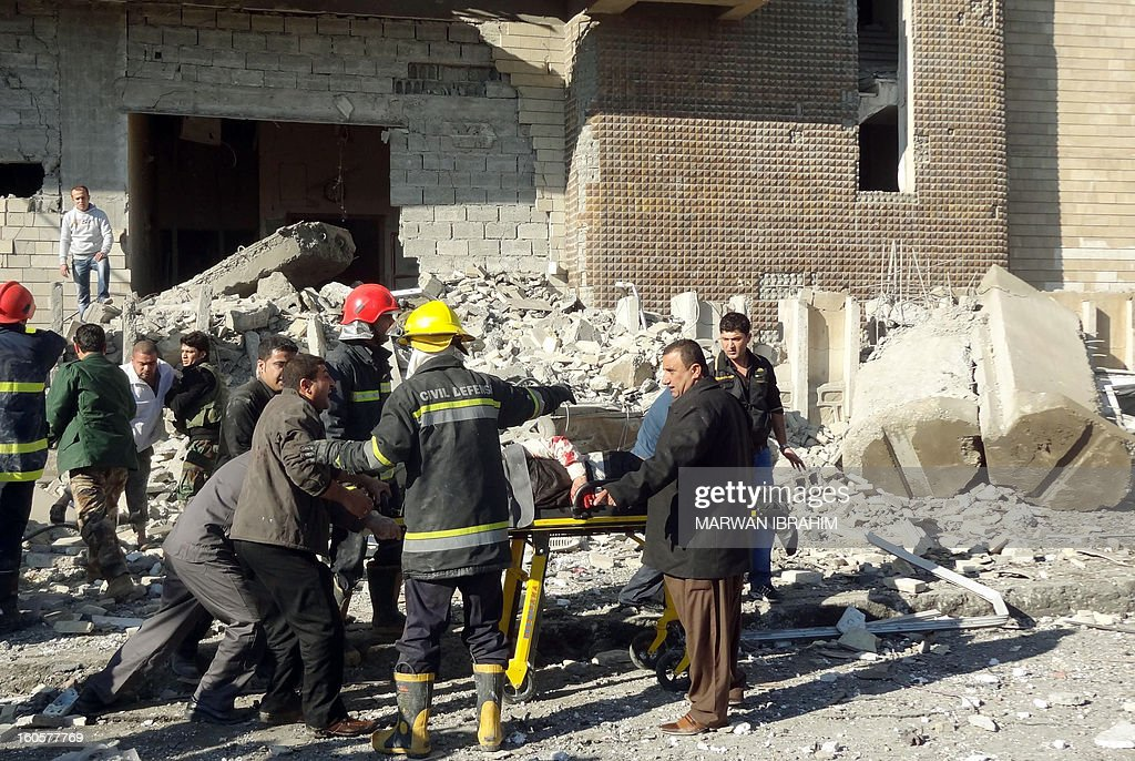 Iraqi rescuers wheel a stretcher from the scene after a car bombing followed by an assault by grenade-throwing gunmen on a police headquarters in a disputed northern city of Kirkuk, on February 3, 2013, killing some 30 people. The vehicle that was detonated in the center of the city was painted to appear as though it was a police car, and the militants who sought to seize the compound were dressed as policemen, witnesses said.