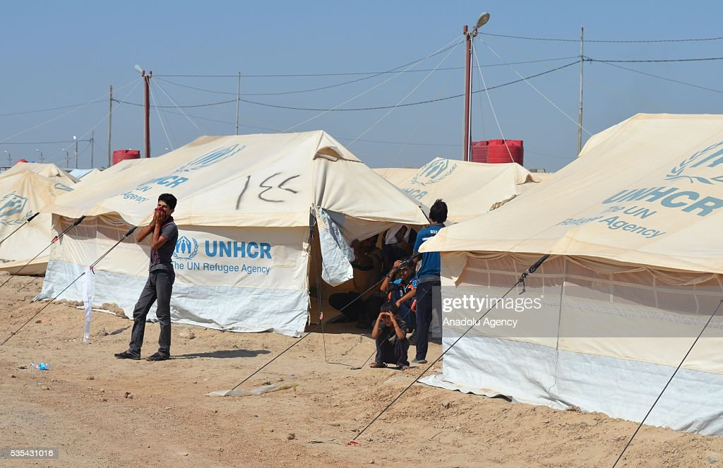 Iraqi residents, fled from ongoing clashes between Iraqi forces and Daesh terrorists in Fallujah, live in harsh conditions in a tent camp near Amiriyah Fallujah city of Al Anbar Governorate of Iraq on May 29, 2016.