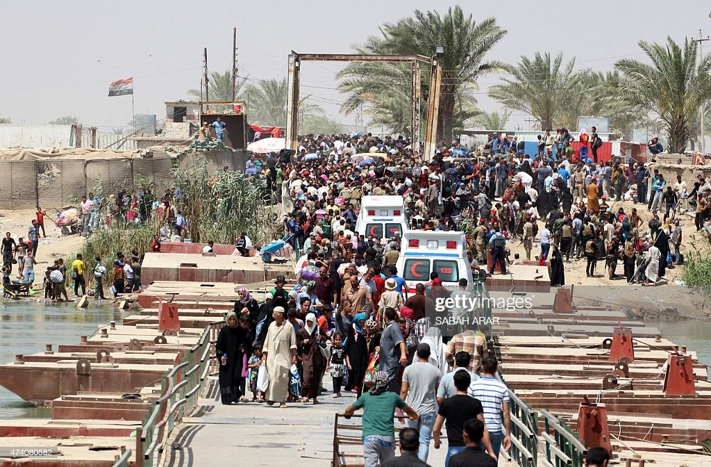 Iraqi residents from the city of Ramadi who fled their homes as Islamic State group militants tightened their siege on the last government positions...