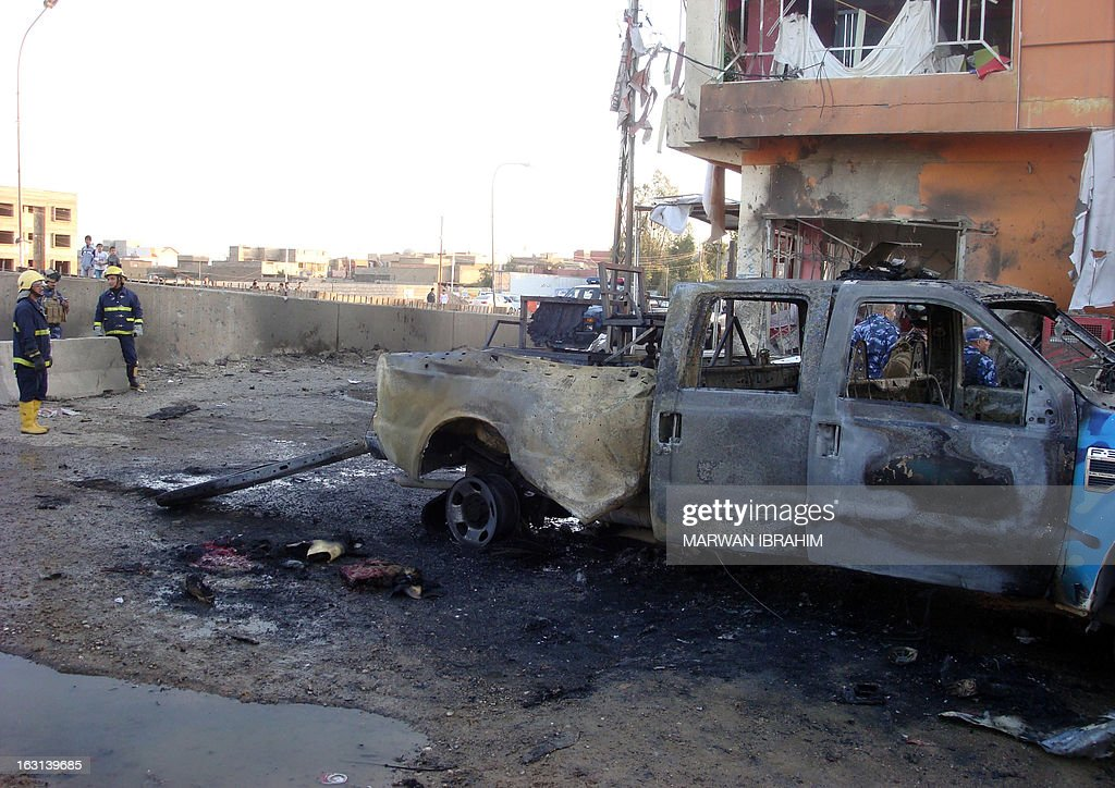 Iraqi security and fire fighters secure the scene following a car bomb, in the northern city of Kirkuk on March 5, 2013. Two car bombs targeted police in the northern city of Kirkuk, killing five and wounding at least 18, while gunmen killed a town council member and a North Oil Company employee south of the city, police and a health official said.