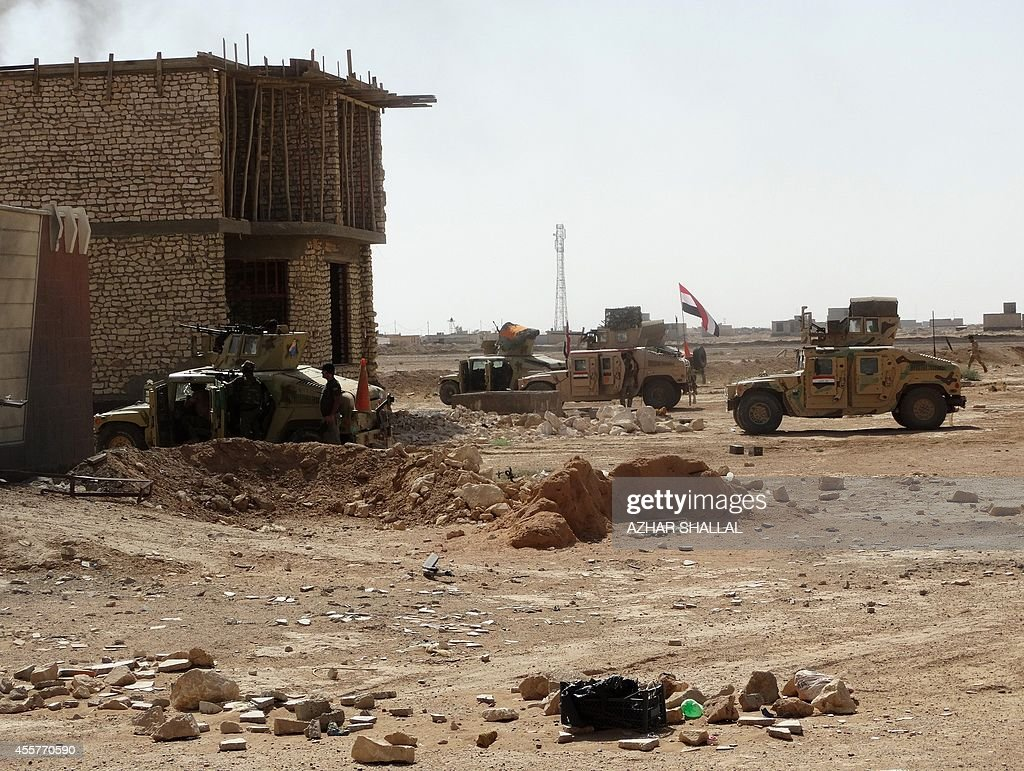 Iraqi security forces and gunmen take positions following clashes with jihadists on September 19 in Ramadi the capital of the western province of...