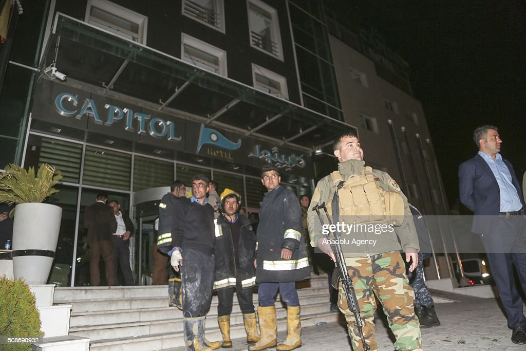 Iraqi security forces and Iraqis gather after a fire incident broke out at a massage center of Capitol Hotel in Erbil, Iraq on February 6, 2016. At least 19 people have been killed and dozens have been injured in a hotel fire in the capital of Iraq's.