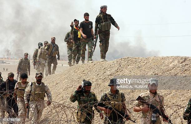 Iraqi security forces and paramilitaries deploy on May 26 in alNibaie area northwest of Baghdad during an operation aimed at cutting off Islamic...