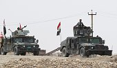 Iraqi security forces and paramilitaries deploy on May 27 in alNibaie area northwest of Baghdad during an operation aimed at cutting off Islamic...