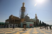 Iraqi security forces and worshippers walk in the courtyard of the Sayyid Mohammed shrine in the Balad area located 70 kilometres north of Baghdad on...