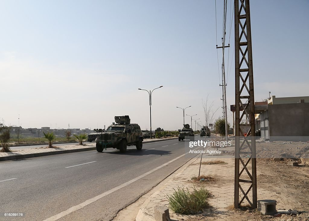 Iraqi security forces' armored vehicles patrol after curfew declared due to the clashes between Iraqi security forces and Daesh for two days, in Kirkuk, Iraq on October 22, 2016.