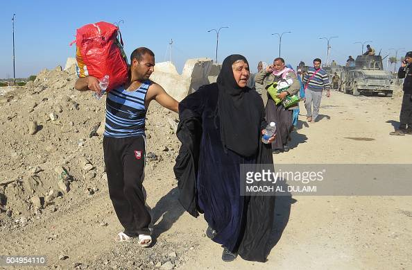 Iraqi security forces evacuate civilians as they clear the Sufiya area on the outskirts of Ramadi on January 14 two weeks after declaring victory...