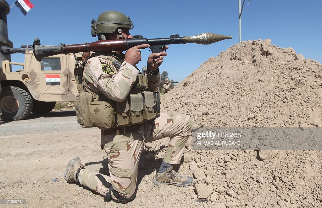 Iraqi security forces hold a position during fighting against jihadists from Islamic State group in the Garma district west of the Iraqi capital...