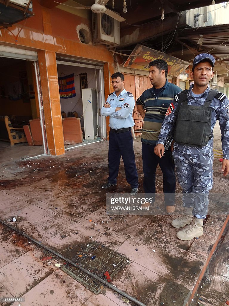 Iraqi security forces inspect the site of a suicide bombing that ripped through a crowded cafe in the northern city of Kirkuk on July 13, 2013. Violence in Iraq killed at least 47 people, with the deadliest attack a suicide bombing at the cafe, police and doctors said. The bomber struck at the cafe as people thronged the streets after the iftar meal that breaks the fast during the Muslim holy month of Ramadan.