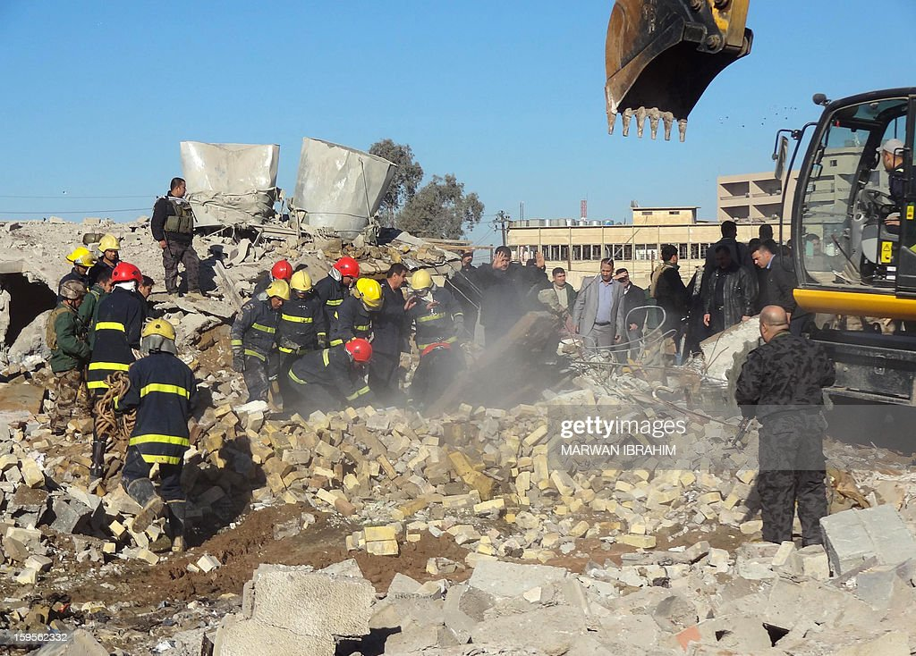 Iraqi security forces inspect the site of an explosion on January 16, 2013 in Kirkuk, 240 kilometres (150 miles) north of Baghdad. A wave of attacks in Baghdad and north of the capital left at least 17 people dead a day after a Sunni MP was killed in a suicide bombing, amid a worsening political crisis engulfing Iraq. AFP PHOTO/MARWAN IBRAHIM