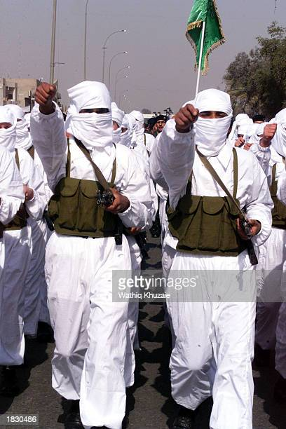 Iraqi security forces march during a parade March 5 2003 in Baghdad Iraq Thousands of security troops and 120 wouldbe suicide bombers marched through...