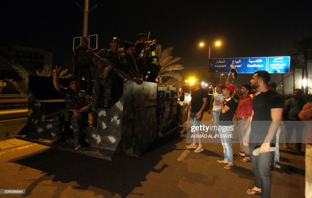 Iraqi security forces patrol the area outside the cabinet building inside Baghdad's heavily fortified 'Green Zone' after angry protesters broke into it on April 30, 2016. Thousands of angry protesters broke into Baghdad's Green Zone and stormed the parliament building after lawmakers again failed to approve new ministers. Jubilant supporters of cleric Moqtada al-Sadr invaded the main session hall, shouting slogans glorifying their leader and claiming that they had rooted out corruption. / AFP / AHMAD