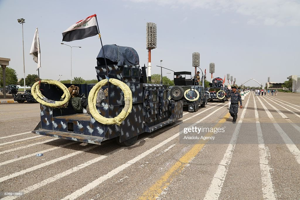 Iraqi security forces stand guard around the Grand Festivities Square as supporters of Shiite cleric Muqtada al-Sadr gather in Baghdad's Green Zone on May 1, 2016.