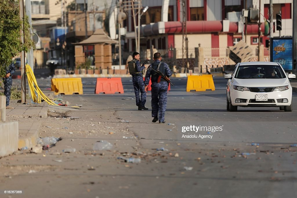 Iraqi security forces stand guard around the Jihad Hotel which was cleared of Daesh after being kept by terrorists for two days, as Iraqi security forces patrol on Kirkuk streets where efforts to clear Daesh continue in Kirkuk, Iraq on October 22, 2016. Thirteen people were killed on Friday by a Daesh suicide attack on a power plant in the northern Iraqi city of Kirkuk. A curfew was imposed in Kirkuk in the wake of other attacks, security sources said.