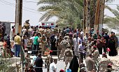 Iraqi security forces stand guard as residents from the city of Ramadi who fled their homes on May 16 2015 as Islamic State group militants tightened...
