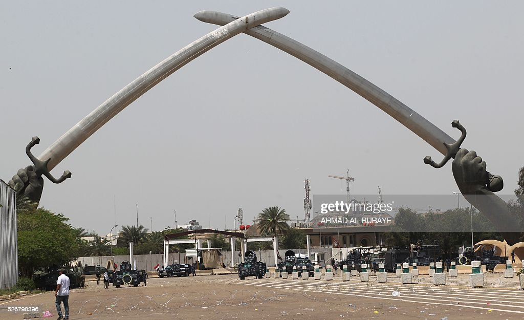 Iraqi security forces stand guard near the 'Crossed Swords monument' in Baghdad's heavily fortified 'Green Zone' on May 1, 2016, the day after supporters of Shiite cleric Moqtada al-Sadr broke into the area when lawmakers again failed to approve new ministers. Thousands of wide-eyed Iraqis marvelled at the fountains, flowers and perfect lawns in the capital's Green Zone, a day after protesters breached the walls of the fortified area. The visitors were mostly protesters who broke in on Saturday but also included Baghdadis taking the opportunity to see an area that was off-limits for so many years that it acquired almost mythical status in the psyche of ordinary citizens. RUBAYE