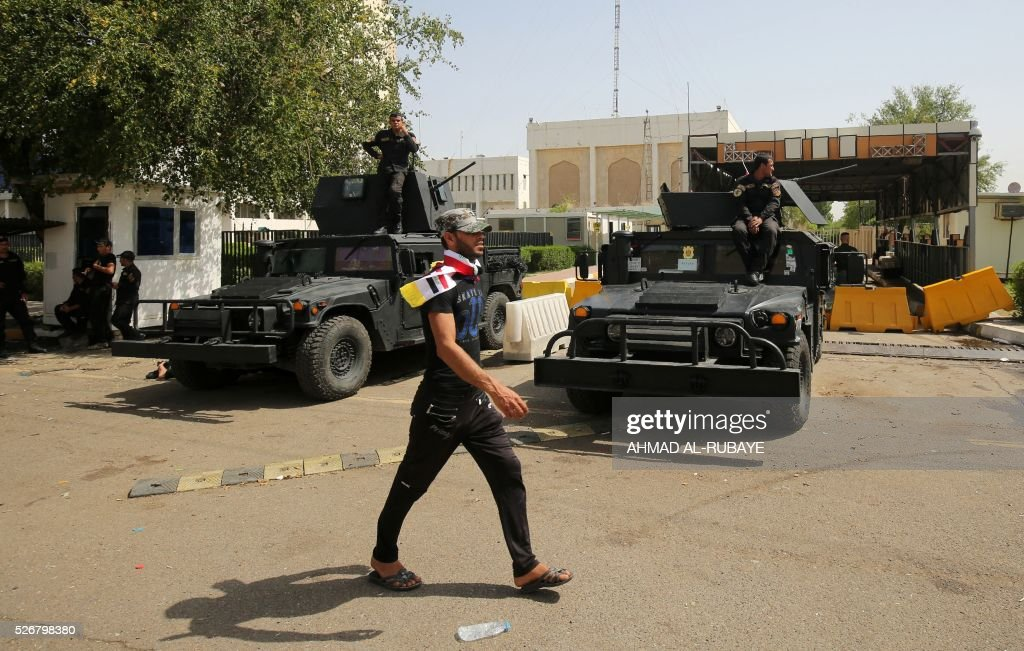 Iraqi security forces stand guard outside the cabinet building in Baghdad's heavily fortified 'Green Zone' on May 1, 2016, the day after supporters of Shiite cleric Moqtada al-Sadr broke into the area after lawmakers again failed to approve new ministers. Jubilant supporters of cleric Moqtada al-Sadr invaded the main session hall, shouting slogans glorifying their leader and claiming that they had rooted out corruption.. AFP/ PHOTO/ AHMAD Thousands of wide-eyed Iraqis marvelled at the fountains, flowers and perfect lawns in the capital's Green Zone, a day after protesters breached the walls of the fortified area. The visitors were mostly protesters who broke in but also included Baghdadis taking the opportunity to see an area that was off-limits for so many years that it acquired almost mythical status in the psyche of ordinary citizens RUBAYE