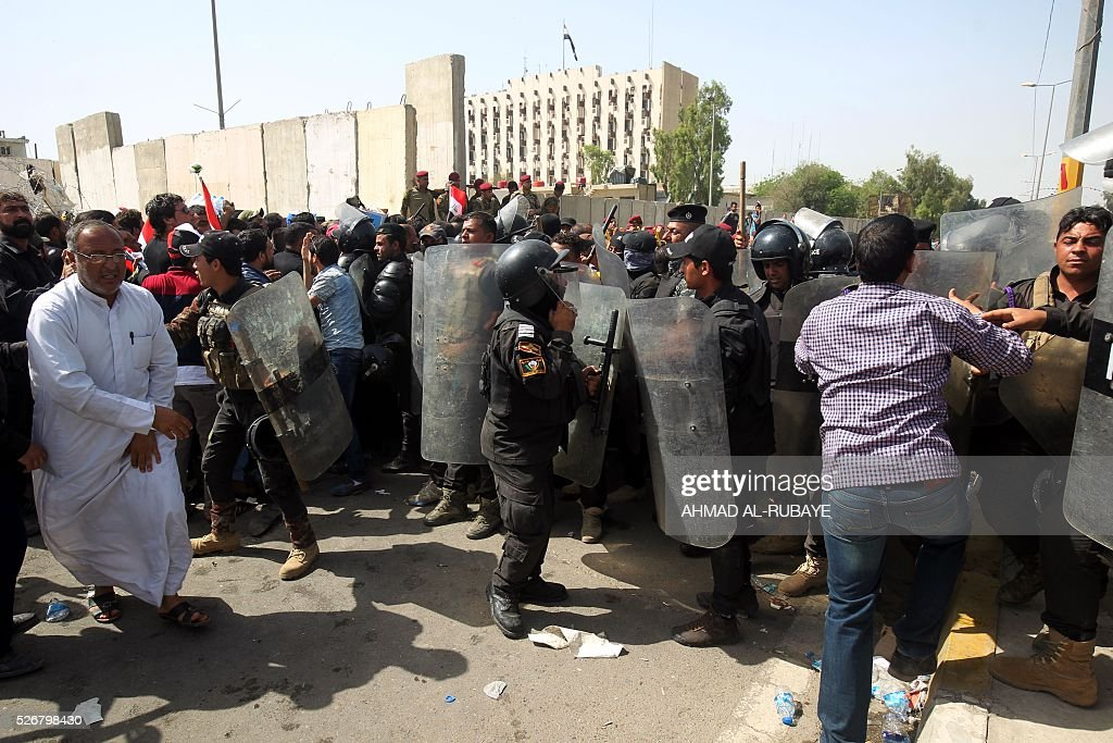 Iraqi security forces try to prevent supporters of cleric Moqtada al-Sadr from entering Baghdad's heavily fortified 'Green Zone' the day after angry protesters broke into the area on May 1, 2016. Thousands of wide-eyed Iraqis marvelled at the fountains, flowers and perfect lawns in the capital's Green Zone, a day after protesters breached the walls of the fortified area. The visitors were mostly protesters who broke in on Saturday but also included Baghdadis taking the opportunity to see an area that was off-limits for so many years that it acquired almost mythical status in the psyche of ordinary citizens. RUBAYE
