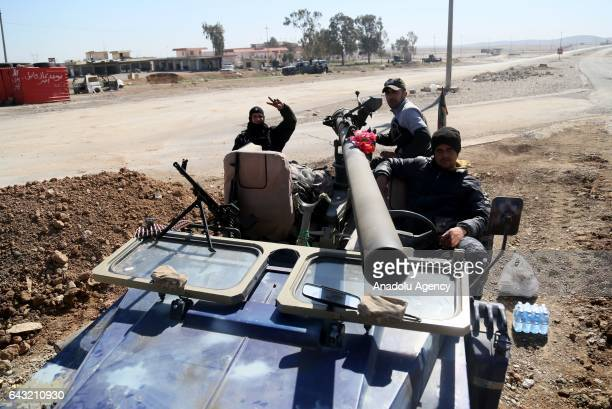 Iraqi security forces with weapons and armored cars attend an operation held to retake western part of Mosul from Daesh in Mosul Iraq on February 20...