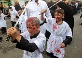 Iraqi Shiite boys take part in a selfflagellation ceremony during a parade to mark Ashura in Baghdad's northern district of Kadhimiya on November 3...
