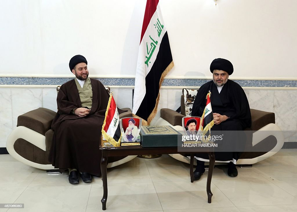 Iraqi Shiite cleric Moqtada al-Sadr (R) and Iraqi Shiite Muslim leader <a gi-track='captionPersonalityLinkClicked' href=/galleries/search?phrase=Ammar+al-Hakim&family=editorial&specificpeople=881718 ng-click='$event.stopPropagation()'>Ammar al-Hakim</a> sit during a meeting to discuss economic and security issues held at Hakim's house in the southern Shiite city of Najaf on January 23, 2015. Al-Sadr expressed his hopes for a unity government and encouraged the efforts of Iraqi Prime Minister Haider al-Abadi in avoiding previously made mistakes. AFP PHOTO/ HAIDAR HAMDANI