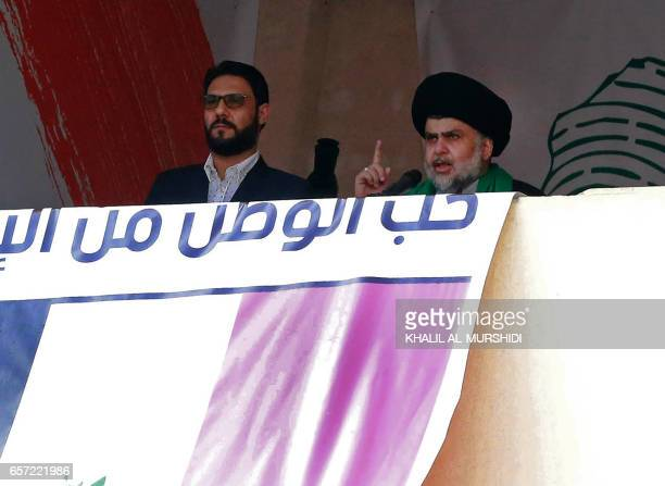 Iraqi Shiite cleric Moqtada alSadr gives a speech to his supporters demonstrating in central Baghdad's Tahrir Square on March 24 2017 The Populist...