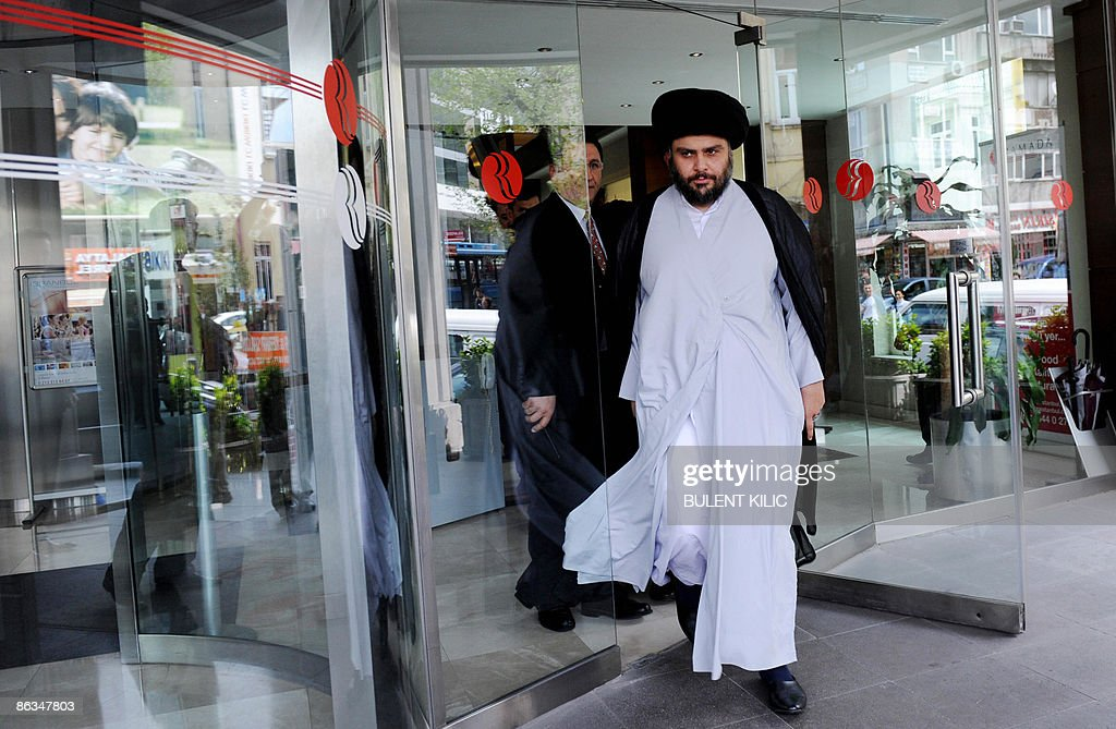 Iraqi Shi'ite cleric Moqtada al-Sadr (R) leaves the Armada Hotel after his meeting in Istanbul, on May 2, 2009. Iraq's Shiite radical leader Moqtada al-Sadr, who has not been seen in public for nearly two years, travelled from Iran to Turkey to discuss his country's future.AFP PHOTO/BULENT KILIC
