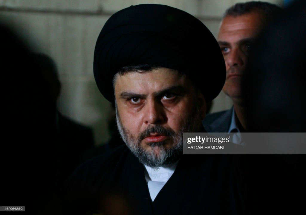 Iraqi Shiite cleric Moqtada al-Sadr looks on during a meeting to discuss economic and security issues held at Iraqi Shiite Muslim leader Ammar al-Hakim's house in the southern Shiite city of Najaf on January 23, 2015. Al-Sadr expressed his hopes for a unity government and encouraged the efforts of Iraqi Prime Minister Haider al-Abadi in avoiding previously made mistakes.