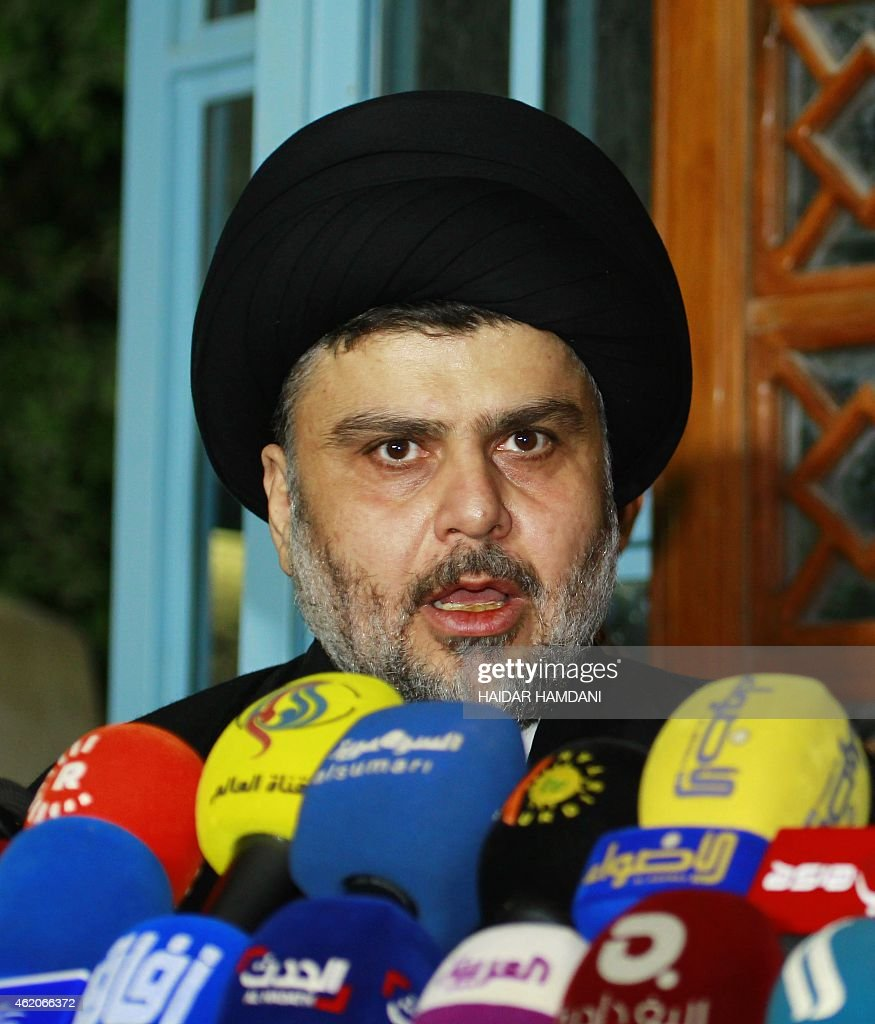 Iraqi Shiite cleric Moqtada al-Sadr looks on during a meeting to discuss economic and security issues held at Iraqi Shiite Muslim leader Ammar al-Hakim's house in the southern Shiite city of Najaf on January 23, 2015. Al-Sadr expressed his hopes for a unity government and encouraged the efforts of Iraqi Prime Minister Haider al-Abadi in avoiding previously made mistakes. AFP PHOTO/ HAIDAR HAMDANI