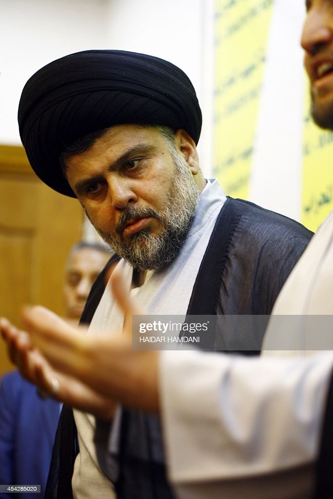 Iraqi Shiite cleric Moqtada alSadr meets with Ammar alHakim the leader of Iraq's Shiite Muslim Supreme Iraqi Islamic Council on August 28 2014 at the...
