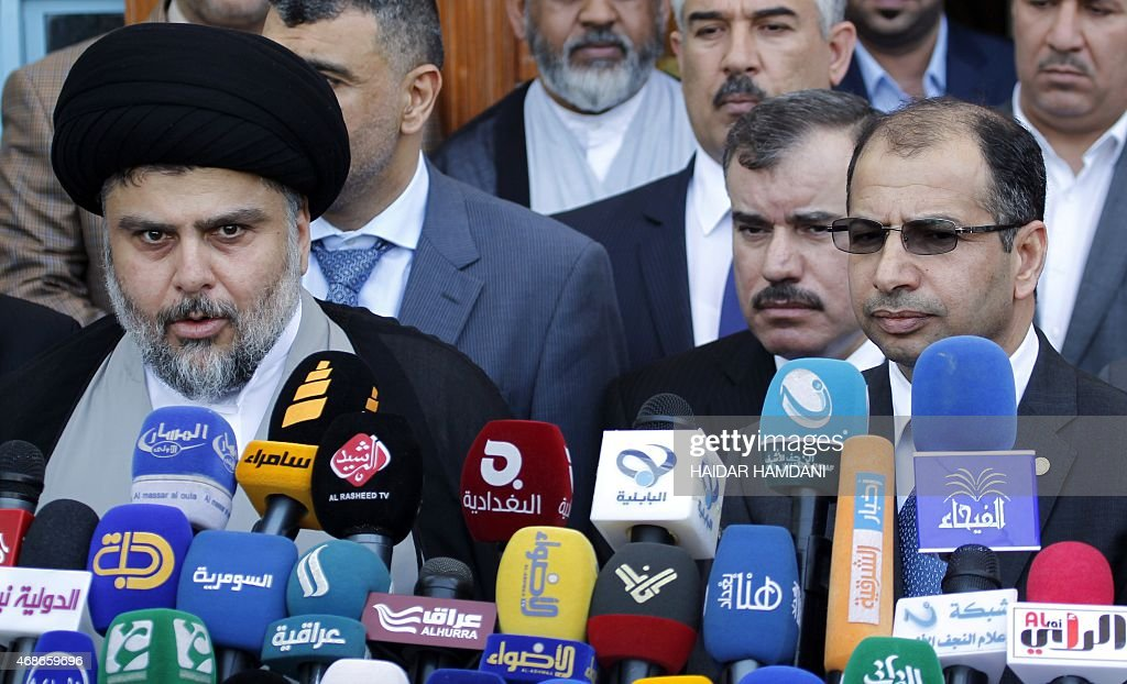 Iraqi Shiite cleric Moqtada al-Sadr speaks to the press after a meeting with Salim al-Jabouri, the Parliament's speaker, alongside other parliament Sunni members on April 5, 2015 in the holy city of Najaf.