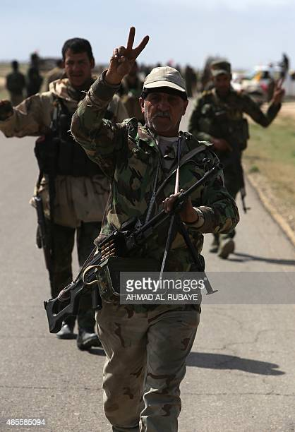 Iraqi Shiite fighters and members of Iraq's Popular Mobilisation units supporting the government forces in the battle against the Islamic State group...