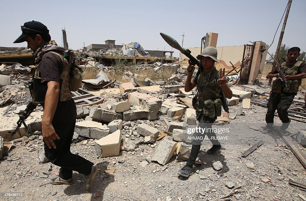Iraqi Shiite fighters from the Popular Mobilisation units deploy in the city of Baiji north of Tikrit as they fight alongside Iraqi forces against...