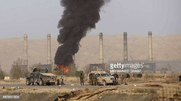 Iraqi Shiite fighters from the Popular Mobilisation units fighting Islamic State jihadists alongside Iraqi government forces are seen opposite...