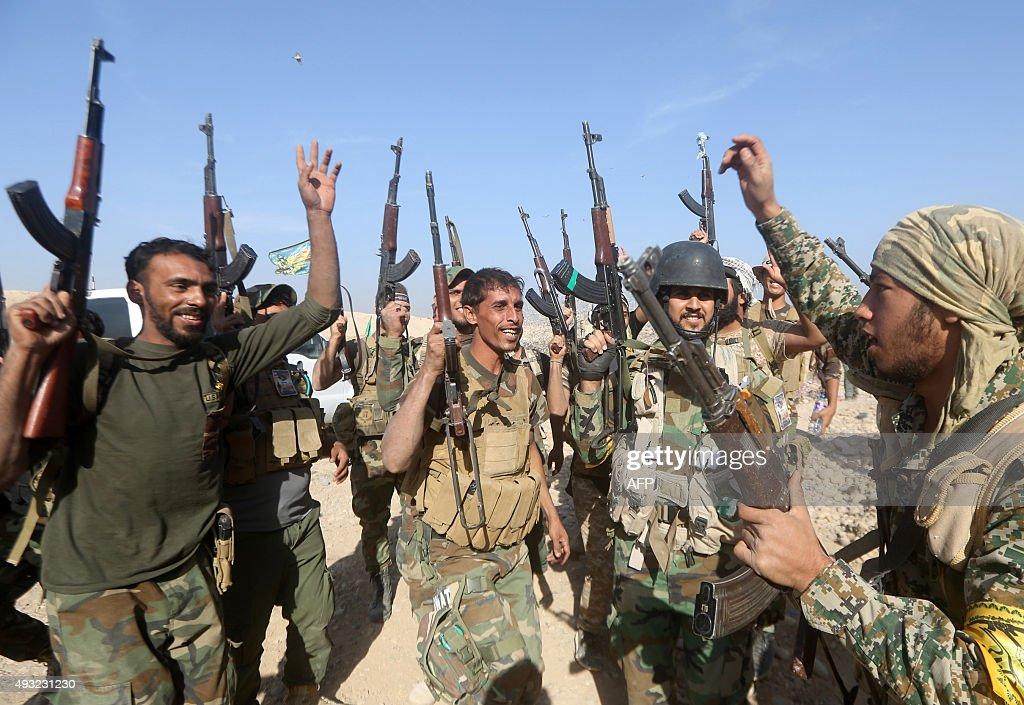 Iraqi Shiite fighters from the Popular Mobilisation units fighting alongside Iraqi forces chant slogans during a military operation against Islamic...