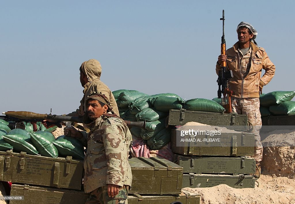 Iraqi Shiite fighters from the Popular Mobilisation units, monitor the frontline near the Tharthar lake, north of the city of Fallujah on February 11, 2016, as they continue to battle Islamic State group (IS) jihadists. RUBAYE