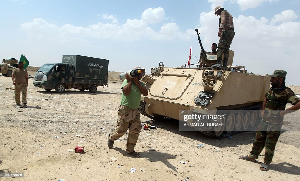 Iraqi Shiite fighters from the Popular Mobilisation units supporting the Iraqi government forces guard a position on July 15 2015 on the northern...