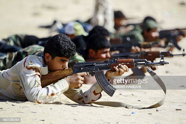 Iraqi Shiite fighters from the Popular Mobilisation units take part in a training session in the holy city of Najaf on October 11 2015 before being...