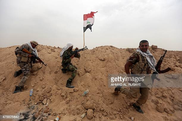 Iraqi Shiite fighters from the Popular Mobilization units hold a position on the Tharthar frontline on the edge of Anbar province 120 kms northwest...
