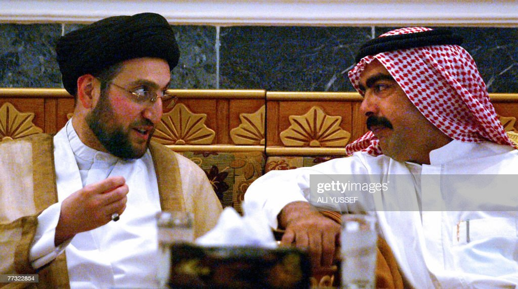 Iraqi Shiite leader Ammar Hakim a leading figure of the Supreme Islamic Iraqi Council and Iraqi Sunni Sheikh Ahmed Abu Risha the brother of slain...